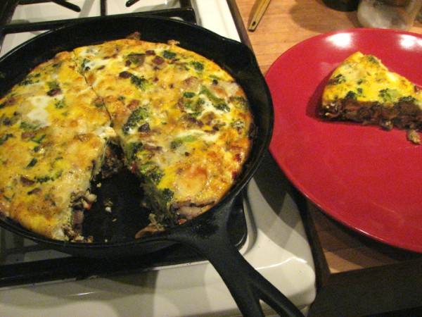 "Photo of <span class=""dquo"">""</span>Chilaquiles"" frittata of broccoli, mushrooms, salsa and corn tortillas; Lokelani green salad"