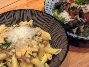 Photo of Seared oyster mushrooms in a mac nut cream sauce over penne pasta; Garden salad